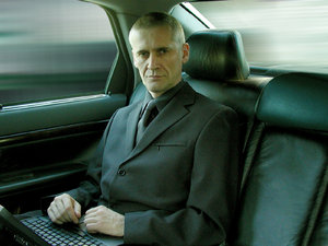 businessman: serious businessman in volvo s80, picture taken with Olympus C-2100 UZ, windows blurred in Photoshop.