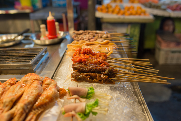 Raw skewers: Various meat and vegetables skewers at street market in China. Night time