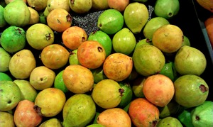 Guavas on display: Collection of various varieties of guava on display in supermarket