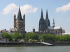 Cologne skyline: Famous Cologne (Germany) skyline with Cathedral (right) and church Groß St. Martin (left) at the riverside; picture taken from a ship on the Rhine river.