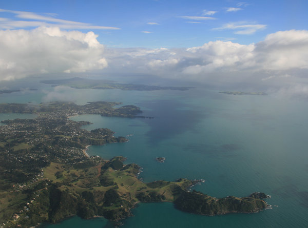 Auckland Aerial: View flying into Auckland, New Zealand, with Mt. Rangitoto in the distance.