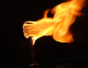 Torch: The interesting thing about this shot is that the flames take the shape of a hand clutching the rod. Four fingers on the top with the thumb pointing south.