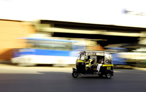 Indian Public transport: Panning technique used to capture an Auto Rickshaw on the streets of Delhi, India.