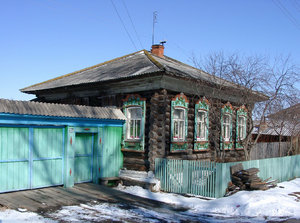 Wooden House and Green Gate: Traditional wooden house and gate in a small Siberian village.