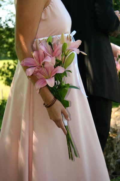 Bride's Maid: Flowers in the hand of a bride's maid