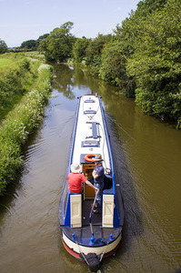 Narrow-boat Cruising: Cruising on a narrow-boat along the Lancaster canal at Barton.