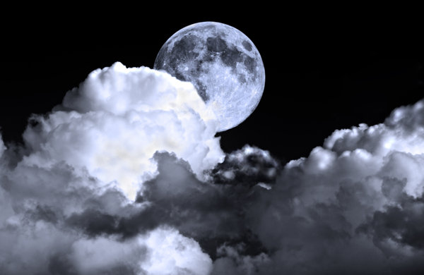 Night Sky: Full moon in a cloudy night sky