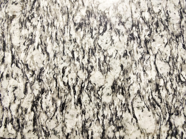 Marble Texture: A ceramic tile with a black and white marble texture.