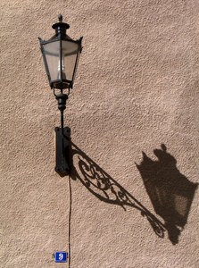 Number 9s revealing shadows...: Streetlight with the shadow revealing the full beauty of the lamp. Which