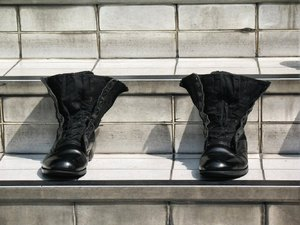 Out for lunch..: Polished boots of a guard who is out to lunch... ;-) /  broke off for lunch- missing in action?
