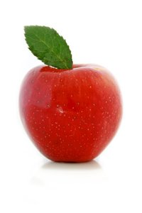 Red Apple: Red skinned apple with a green leaf against a white background