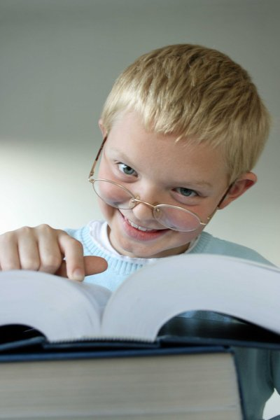 Homework Kid: Cute kid with large educational reference books