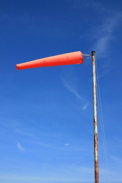 Windsock: An orange coloured aviation windsock against a blue sky