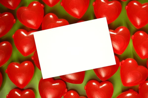 Valentine Card: White card on a background of red hearts
