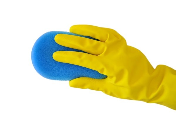 Scrub: Yellow gloved hand with a kitchen scrub