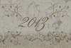 2013 i: A grungy 2013 banner with an ornate floral motif.