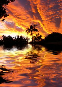 Tropical Waters 2: Spectacular sunset (the colours are not intensified) over tropical waters. Photo and graphic.