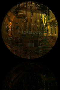 Circuit 3: Shiny round 3d button with a circuit layout. Great science fiction illustration, tech or computer abstract.