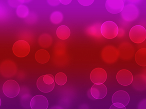 Bokeh or Blurred Lights 2: Bokeh, or blurred background lights in red, pink and purple. Suitable for a background, Christmas greetings, holiday greetings, texture, or fill.