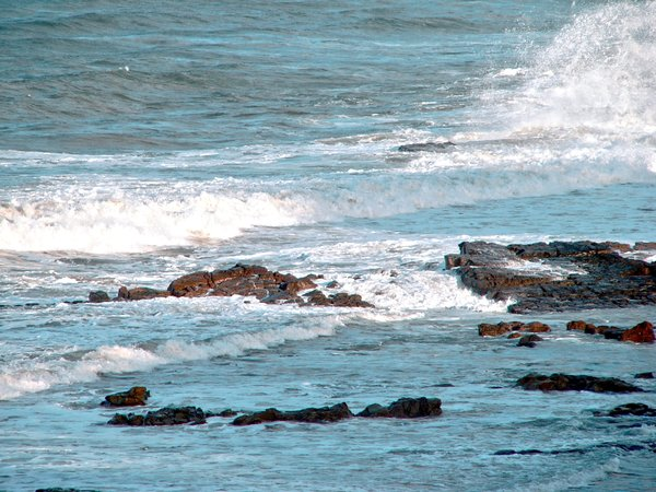 Ocean Waves 2: Waves in a choppy sea, crashing against rocks.