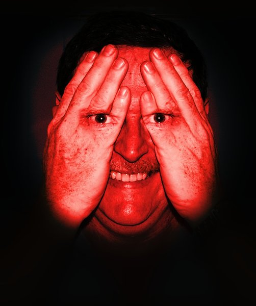 I can still see you...3: A spooky image of a man hiding his face, but his eyes are visible through his hands. Has a scary smile and a strange expression in his eyes. Blood red effect. Could be a spy or the NSA. You may like:  http://www.rgbstock.com/photo/nbtJ04e/I+can+still+see+you...2