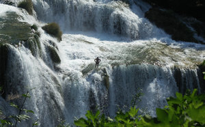 Man in waterfall Krka: A man standing in the middle of Krka waterfall in Croatia