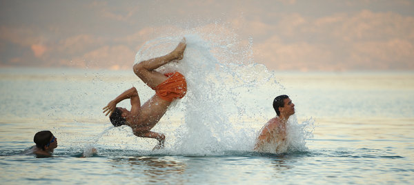 Young boys jumping in the sea: Young boys jumping in the sea