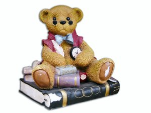 Study bear: little stone bear on books