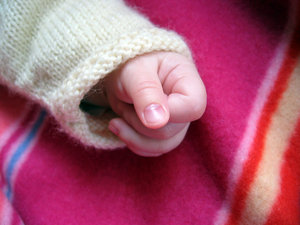 Little hand: baby hand on a blanket