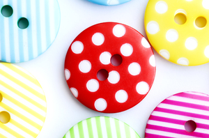 Cute as a......: Colored buttons on white background