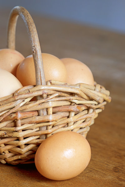 Egg basket: basket with brown organic eggs